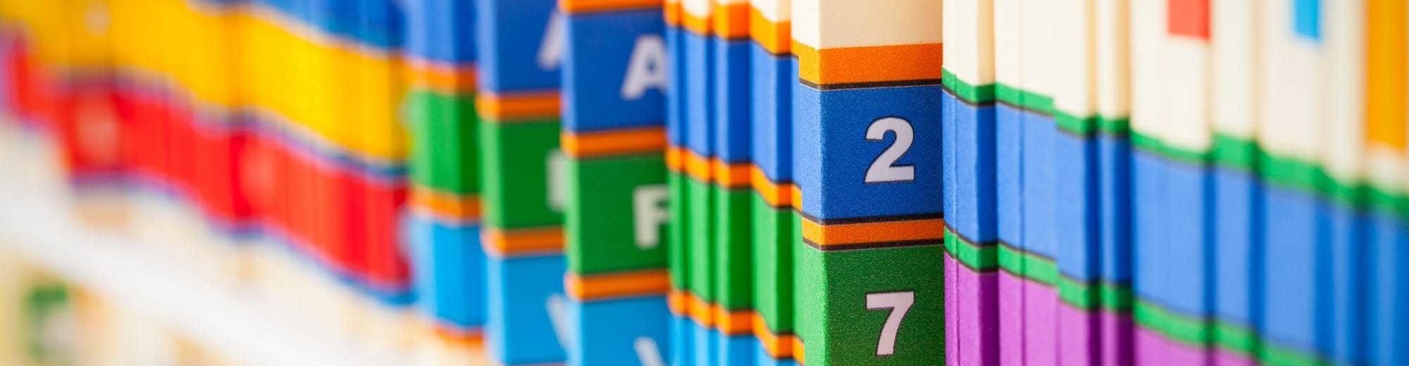Office Shelf with Medical Files - Data Management Services | Amarex