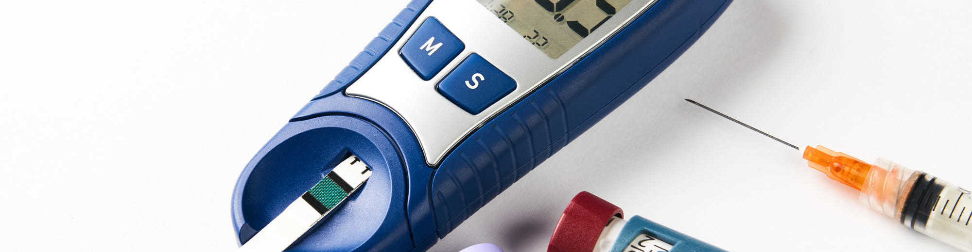 Diabetic Measuring Lancet Instruments on White Background - Biostatistics services | Amarex