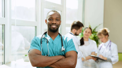 Male nurse with staff in hospital - Clinical | Amarex